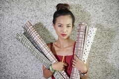 Woman holding gift paper rolls stock photos