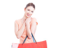 Woman holding gift shopping bags smiling and feeling pleased Stock Image