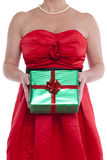 Woman holding gift wrapped present. Royalty Free Stock Images