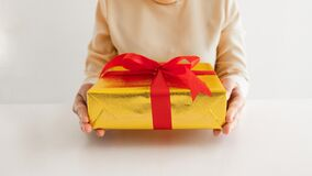 The woman holding a giftbox