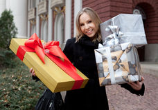 Woman holding gifts Royalty Free Stock Photos