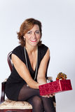 Woman holding gifts Stock Photos