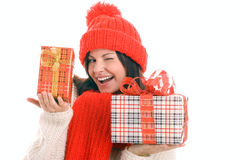 Woman holding gifts winking Stock Photos