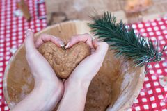 Woman holding gingerbread dough at hands in the Stock Photo