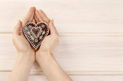 Woman holding gingerbread heart Royalty Free Stock Photo