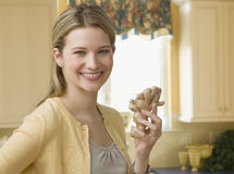 Woman Holding Ginseng in the Kitchen royalty free stock photos