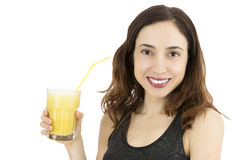 Woman holding a glass of banana smoothie. Attractive smiling caucasian woman holding a glass of smoothie Stock Image