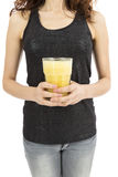 Woman holding a glass of banana smoothie. Woman holding in her hands abig glass of banana smoothie. Isolated on white background Royalty Free Stock Photography