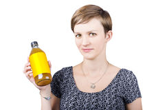 Woman holding glass bottle of apple cider vinegar Royalty Free Stock Photography