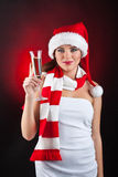 A woman holding a glass of champagne Stock Photos
