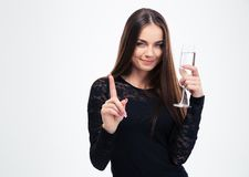 Woman holding glass with champagne Royalty Free Stock Images