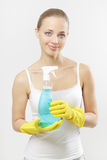 Woman holding glass cleaner Stock Images