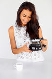 Woman holding a glass coffee pot in her kitchen stock photo