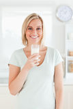 Woman holding glass filled with milk Royalty Free Stock Image