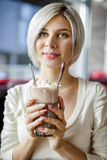 Woman Holding Glass Of Hot Chocolate With Cream In Cafe Stock Photos
