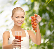 Woman holding glass of juice and tomatoes Royalty Free Stock Photo