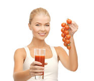 Woman holding glass of juice and tomatoes Royalty Free Stock Images