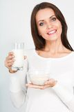 Woman holding glass of mik and bowl with oatmeal Stock Images