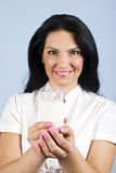 Woman holding a glass with milk. Happy woman holding  a glass with milk with both hands in front of image,focus on glass milk,check also my collection Healthy Royalty Free Stock Photos