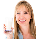 Woman holding a glass of milk Stock Image
