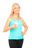Woman holding a glass of milk Stock Photo