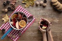 Woman holding glass of mulled wine Stock Photo