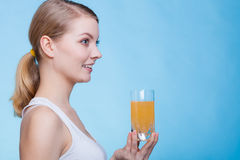 Woman holding glass of orange flavored drink Royalty Free Stock Photo