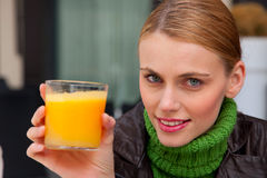 woman holding a glass of orange juice Stock Image