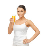 Woman holding glass of orange juice Stock Photography