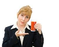 Woman holding glass of tomato juice. Healthy eating - attractive business woman holding a glass of fresh tomato juice. Isolated on white Royalty Free Stock Photos