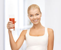 Woman holding glass of tomato juice Royalty Free Stock Images