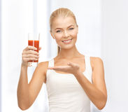 Woman holding glass of tomato juice Stock Image