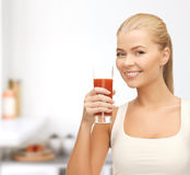 Woman holding glass of tomato juice Royalty Free Stock Photography