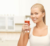 Woman holding glass of tomato juice Stock Photos