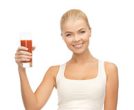 Woman holding glass of tomato juice Stock Photo