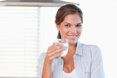 Woman holding a glass of water Royalty Free Stock Photos