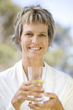 Woman holding a glass of water Royalty Free Stock Images