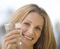 Woman holding a glass of water, close-up Royalty Free Stock Images