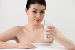 Woman holding glass of water Royalty Free Stock Photos