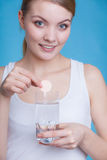 Woman holding glass with water and effervescent tablet Royalty Free Stock Photos