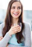 Woman holding glass of water Stock Images