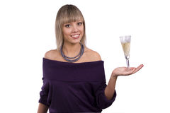 Woman is holding a glass of white wine Royalty Free Stock Photos