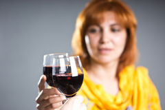 Woman holding a glass of wine. Adult woman holding a glass of wine Royalty Free Stock Photography