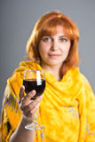 Woman holding a glass of wine Royalty Free Stock Photos