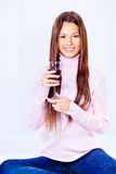 Woman holding glass of wine. Happy woman holding glass of wine Royalty Free Stock Photo