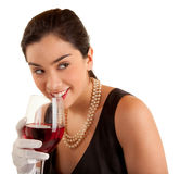 Woman Holding Glass of Wine Looking Sideways Stock Photos