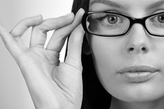 Woman holding glasses. Business woman portrait wearing glasses - black and white photo Royalty Free Stock Photos