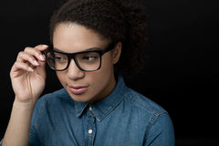 Woman holding glasses. Isolated on black background royalty free stock photo