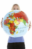 Woman Holding Globe Stock Photo