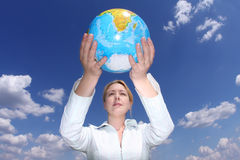 Woman holding globe Royalty Free Stock Images